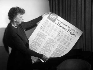 Eleanor Roosevelt holding Dec of Human Rights